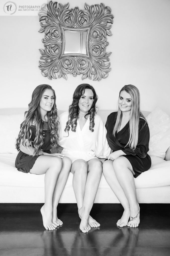 Bride & Bridesmaids sitting on couch