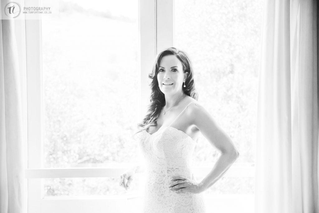 Bride posing infront of window