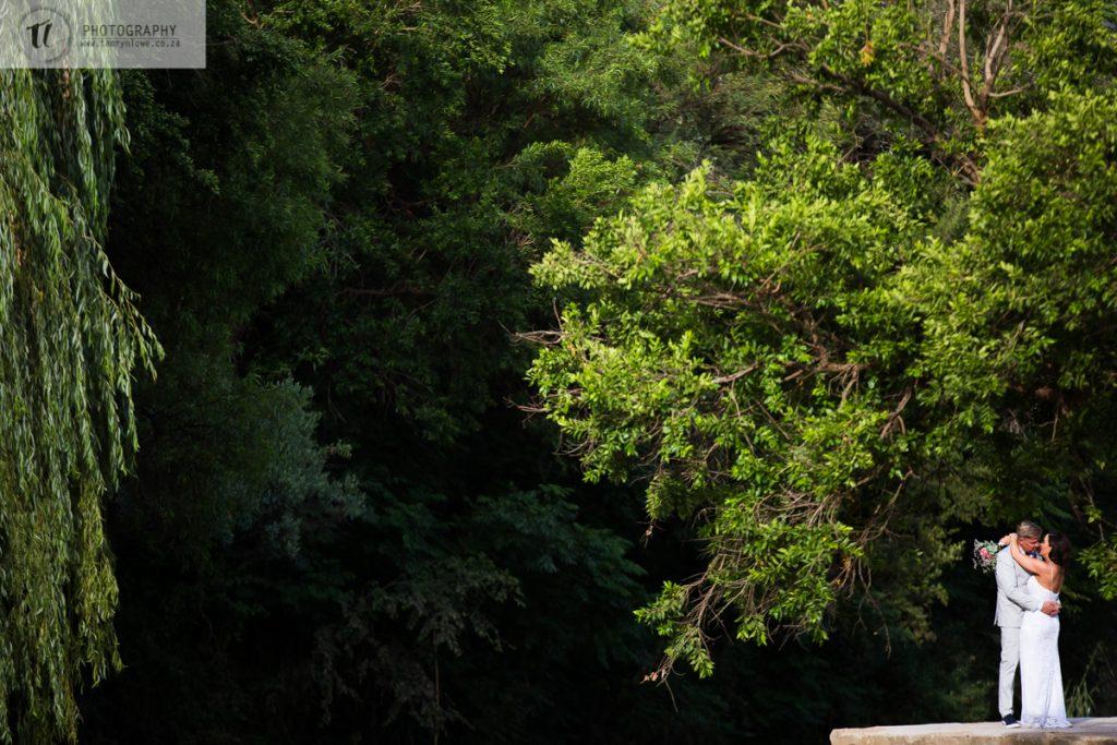 Bride & Groom dance under a tree