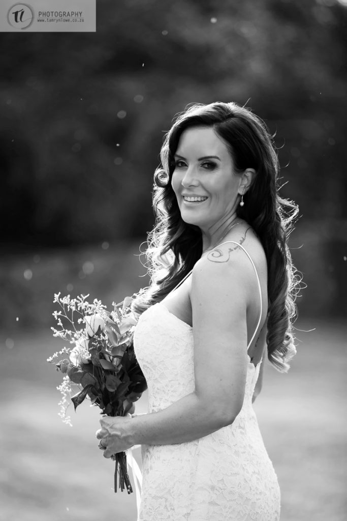 Bride with rain in the background