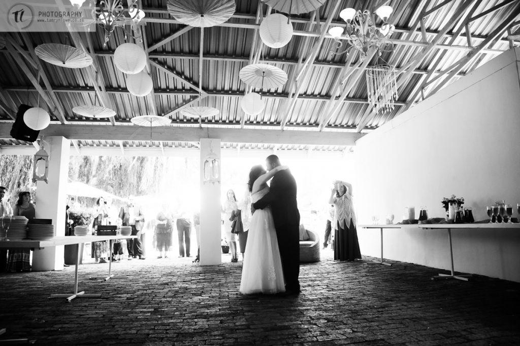Black and white of Bride & Groom dancing