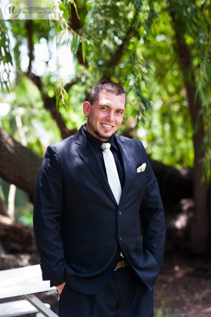 Groom portrait in forest