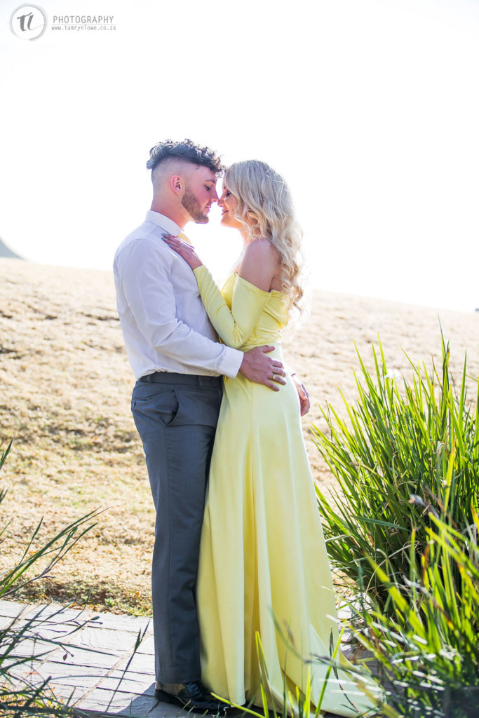 Young couple about to kiss in formal attire