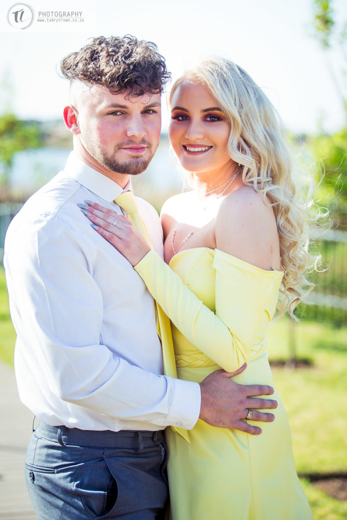 Close up of young couple in formal attire posing together
