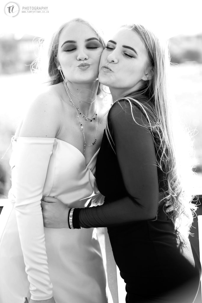 Black and white picture of two young ladies pouting