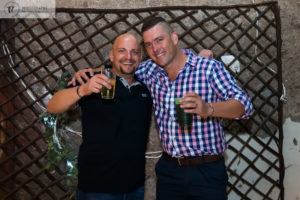 Two Guys with drinks at a party