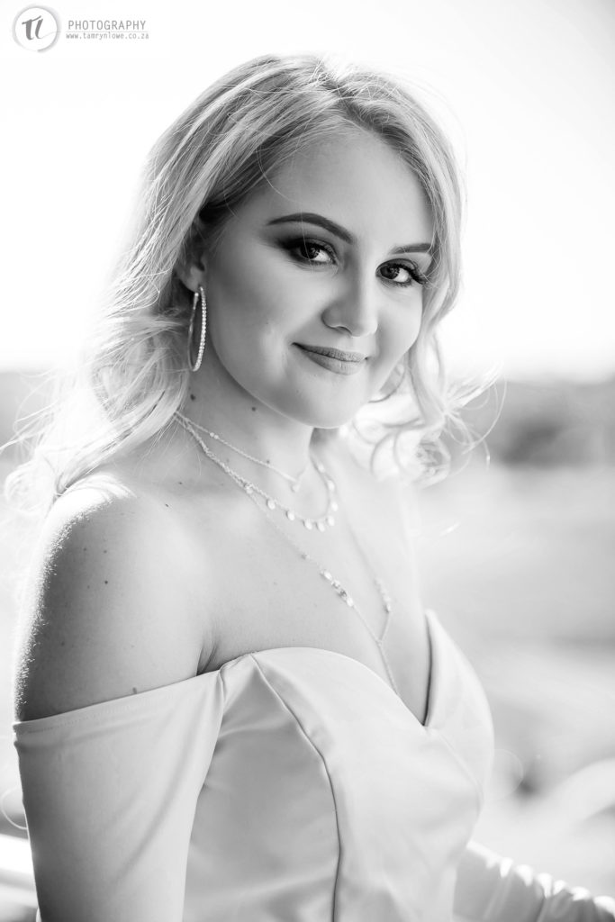 Black and white close up of girl in formal dress