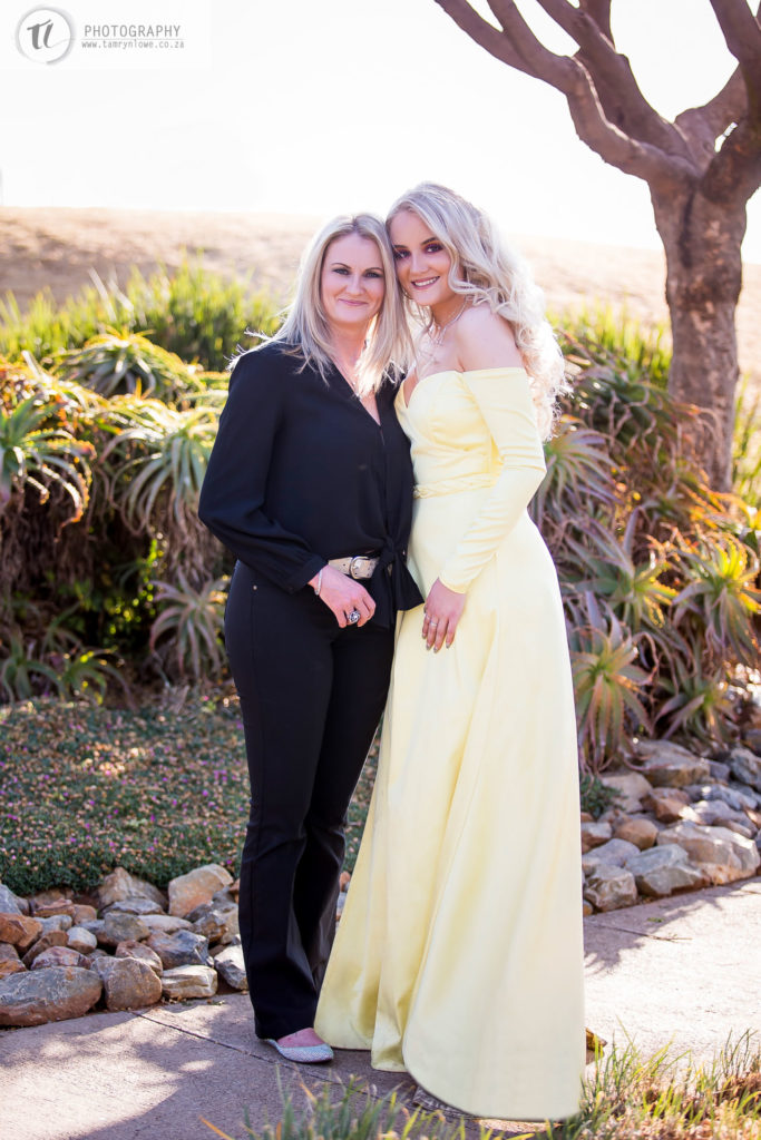 Young lady in formal attire with her mom
