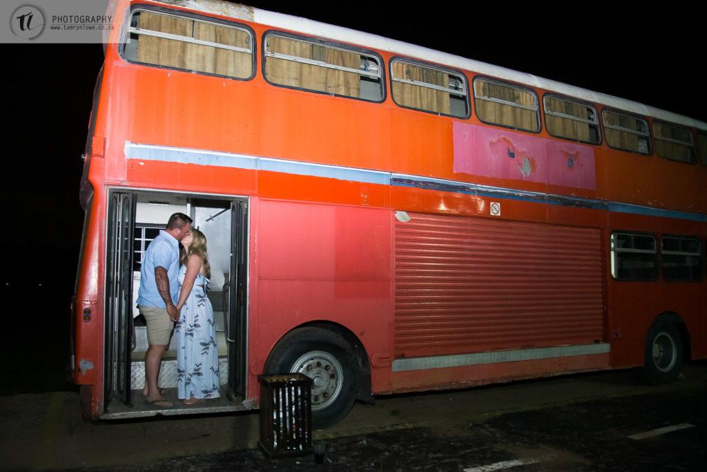 Newly Engaged Couple at Bus Entrance