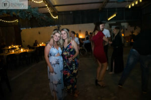 Two ladies posing together on the dance floor
